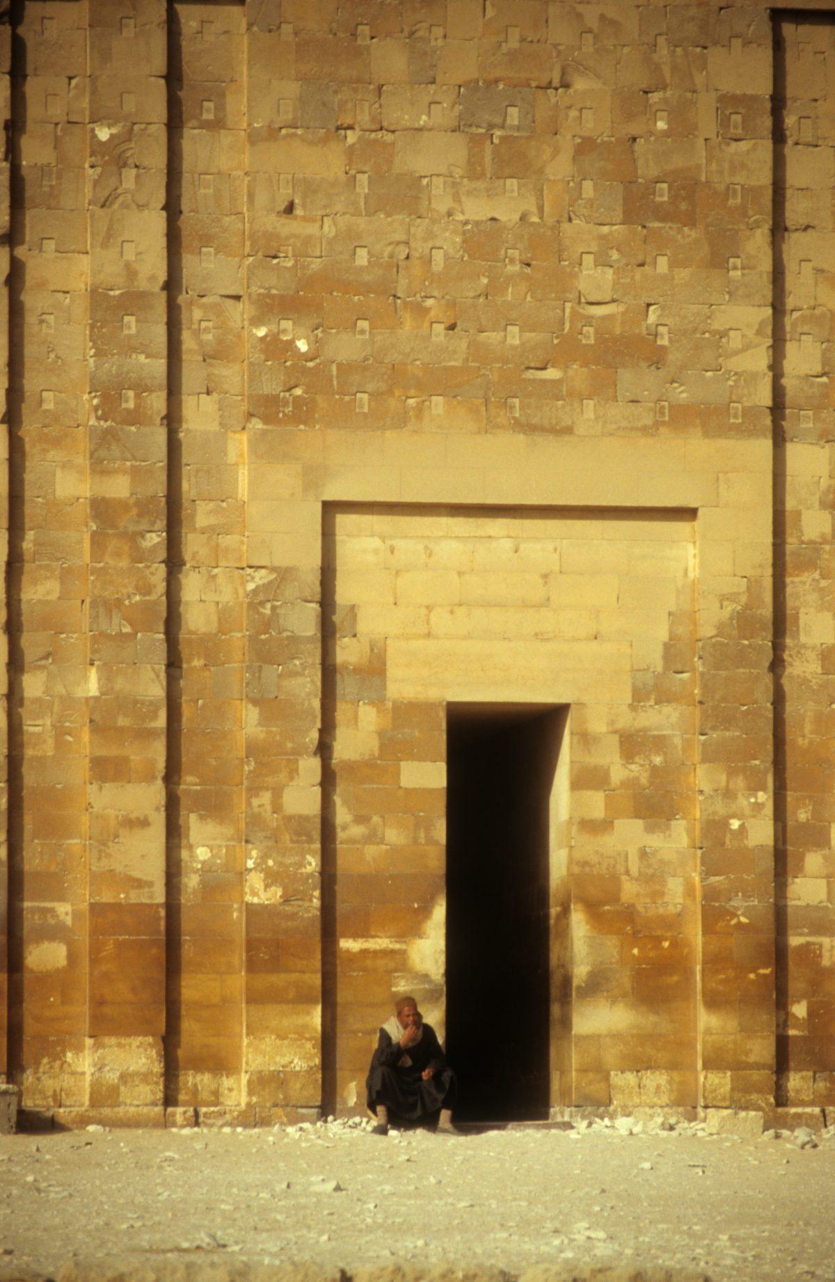 door, male, landmark, sand