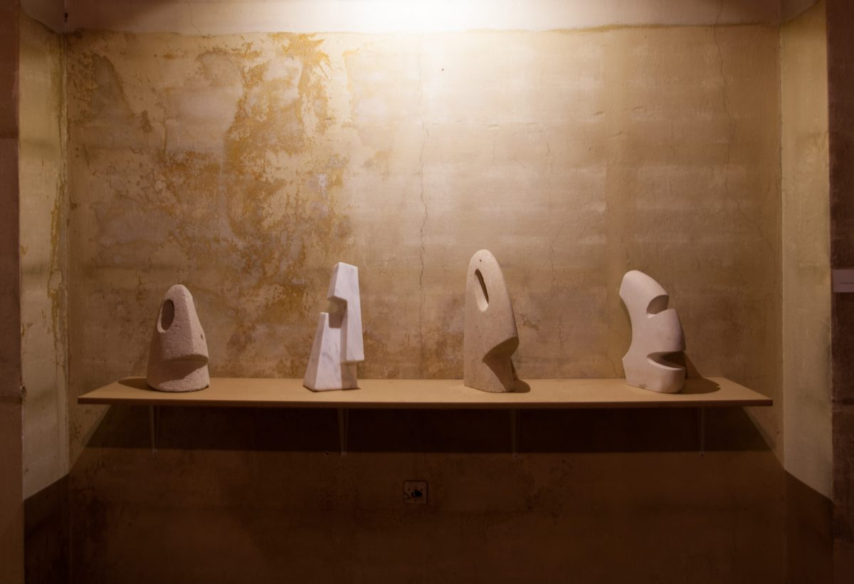 figures - series of stone sculptures, exhibition, sculpture, ch3, wall