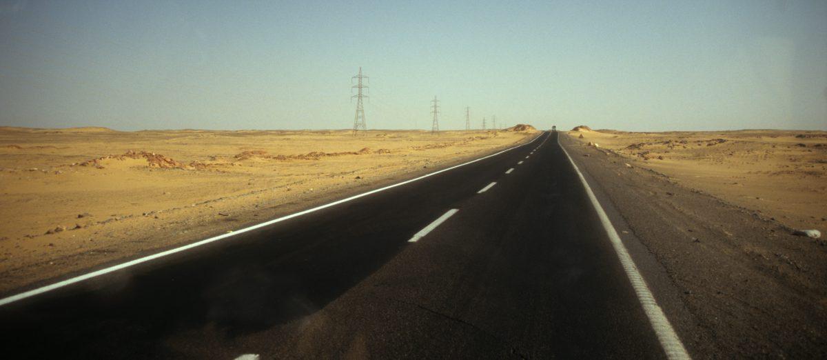 Never ending road, street, desert, sand