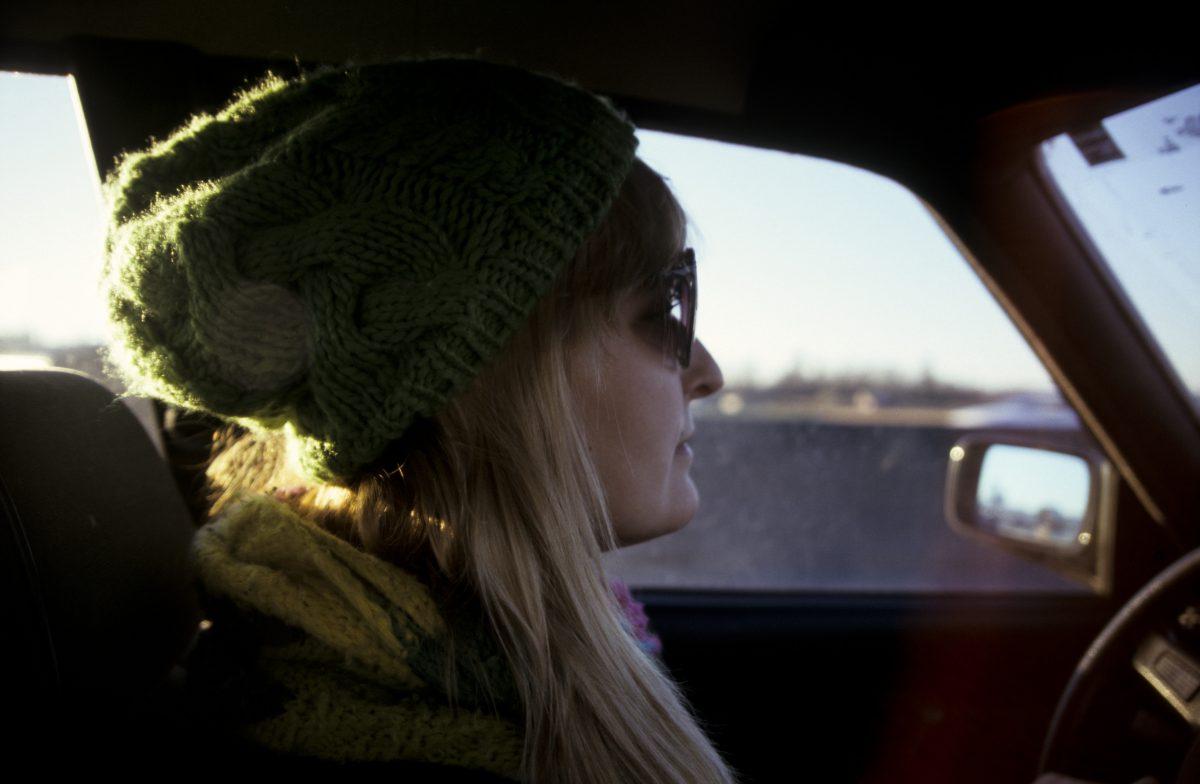 Jenny on the wheel, female, car