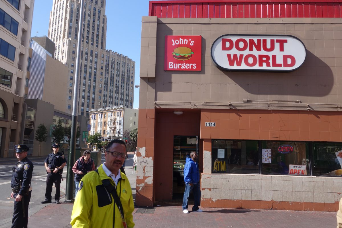 Cycling tour - Vancouver to LA - Cups and donuts, restaurant, male, police, building