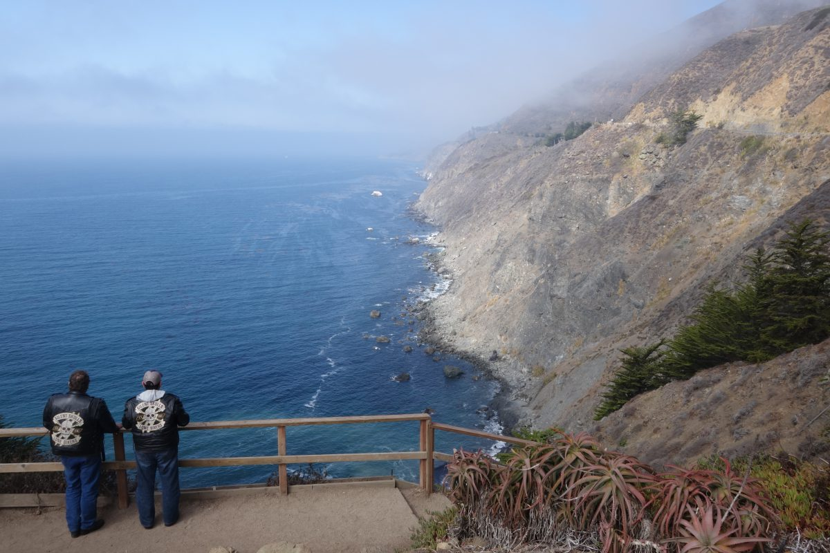 Cycling tour - Vancouver to LA - Rugged coastline, fog, male, sea, cliff